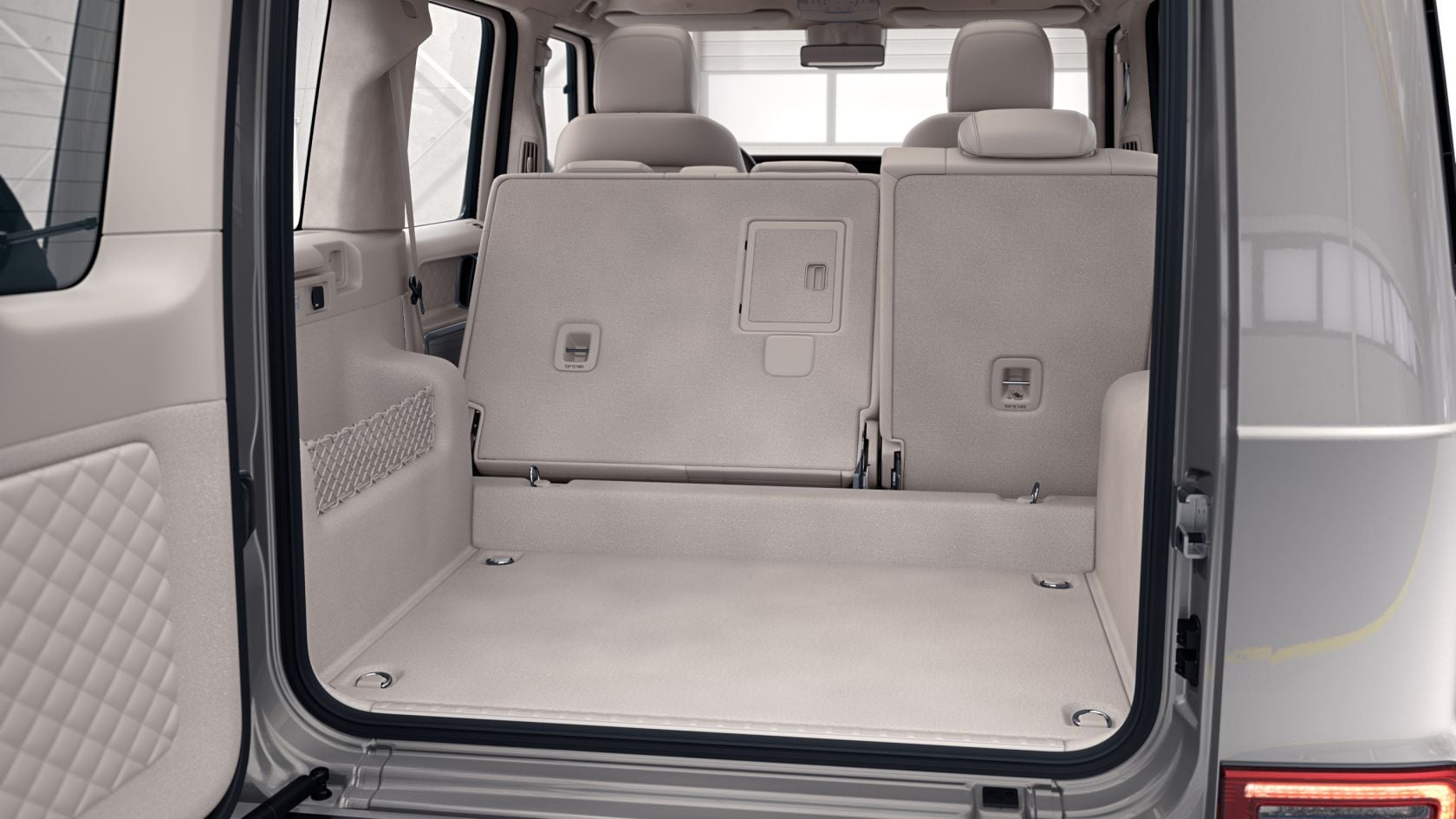 Mercedes-Benz G-Class: folding seat backrests in the rear
